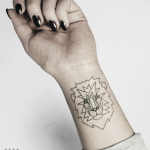 Lion tattoo on the wrist by Warda