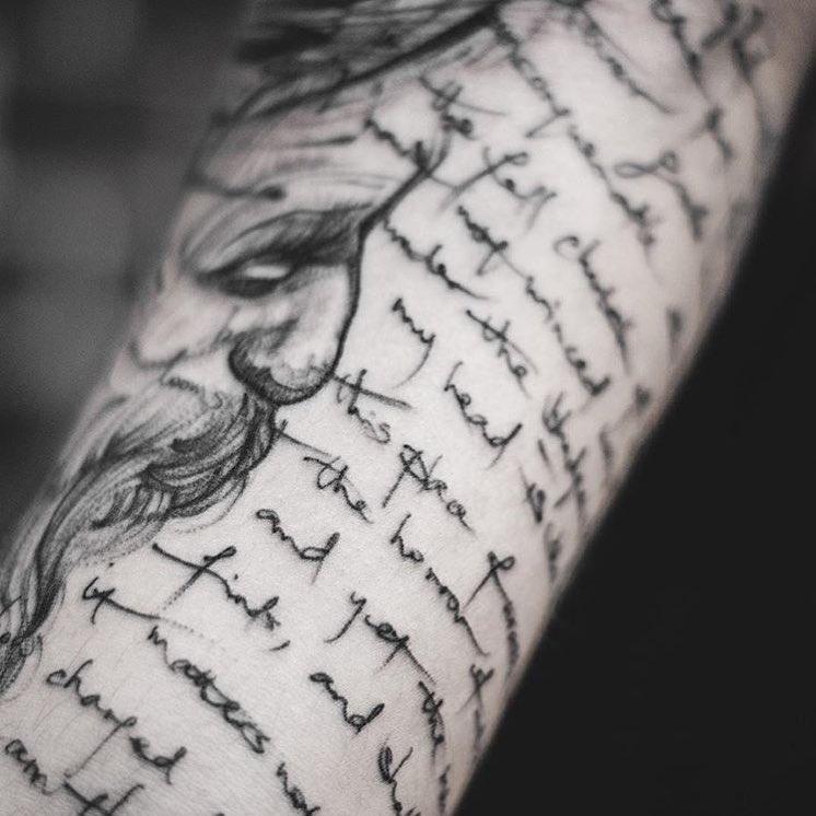 Long script tattoo by Yi Postyism