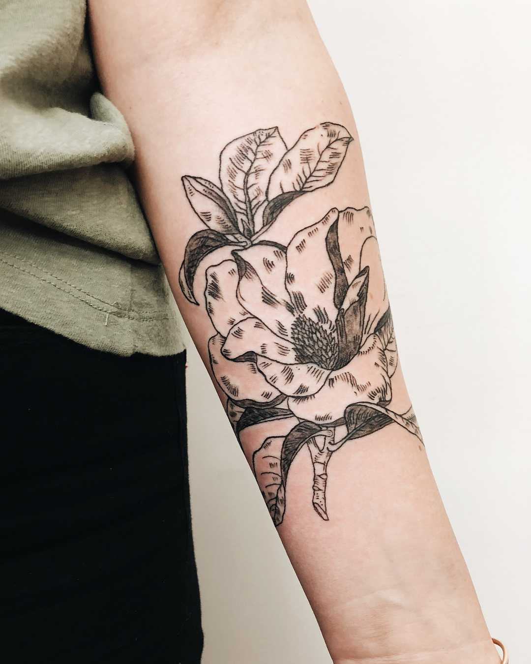 Magnolia bloom tattoo by Finley Jordan