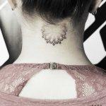 Mandala tattoo on the neck by Warda