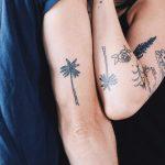 Matching palm tree tattoos by Kelli Kikcio