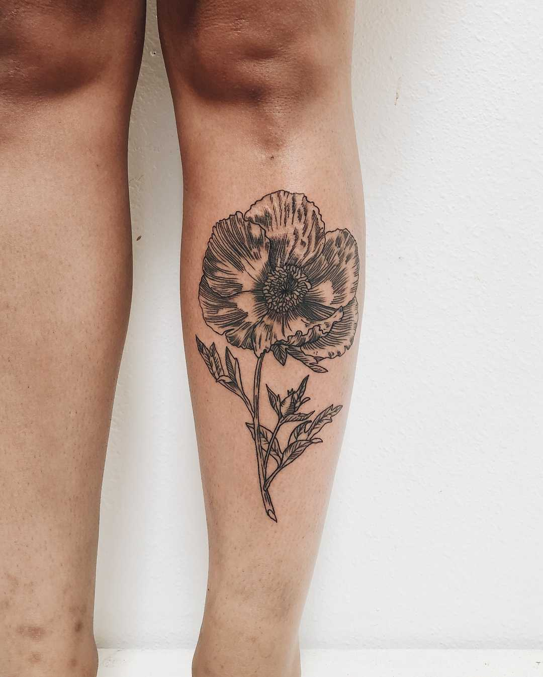 Matilija poppy tattoo by Finley Jordan