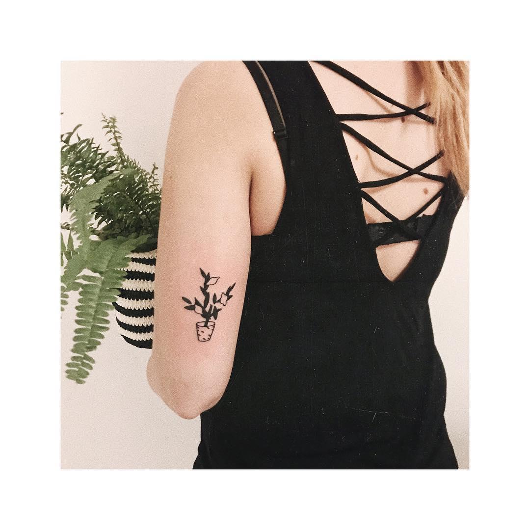 Minimalist flower pot tattoo