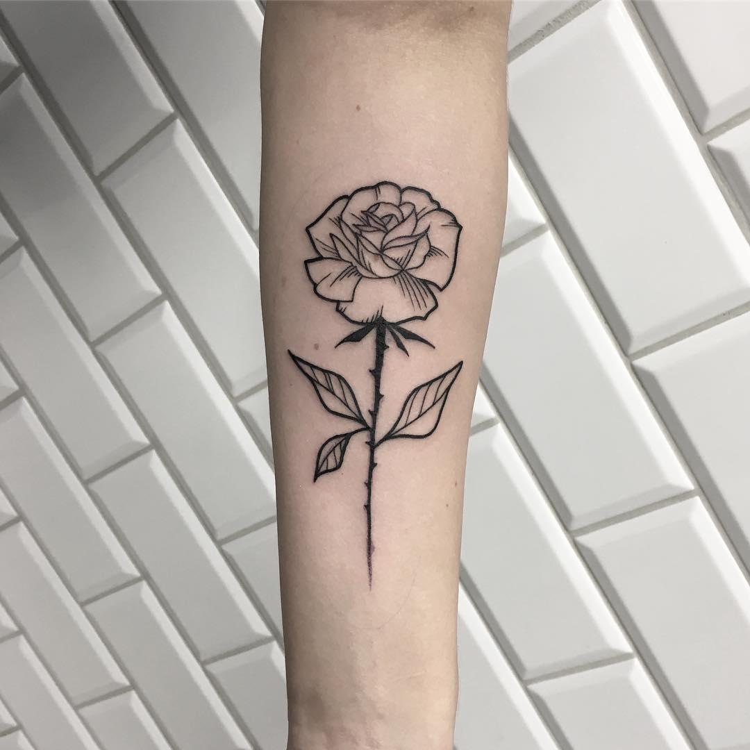 Minimalist rose done at Kult Tattoo Fest