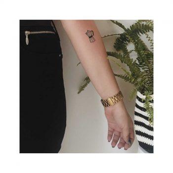 Mokka pot tattoo on the left forearm