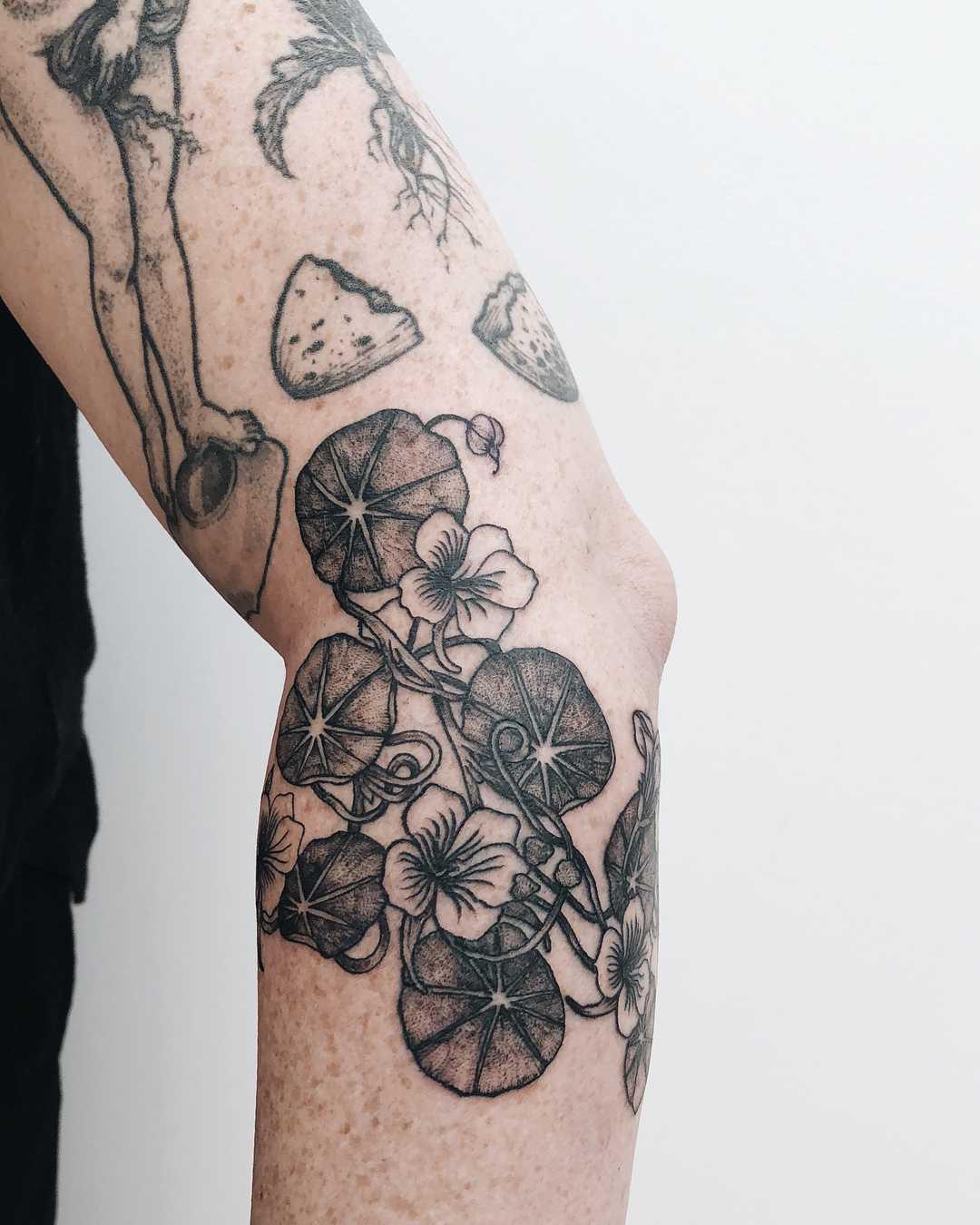 Nasturtiums tattoo by Finley Jordan