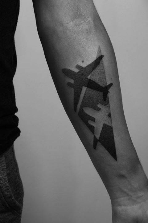 Negative space airplane tattoo