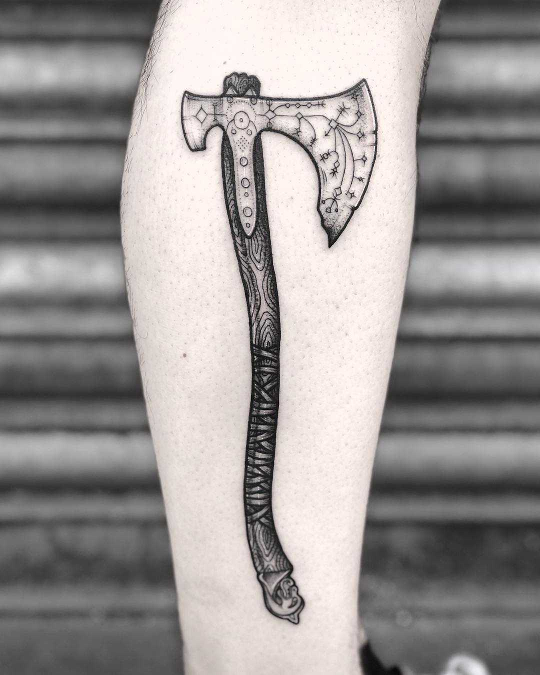Norse ax tattoo by Lozzy Bones