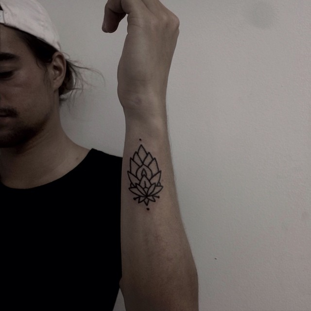 Ornamental linear flower tattoo