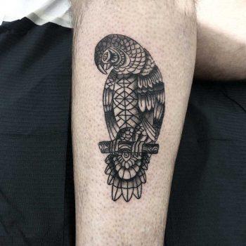 Ornamental parrot tattoo