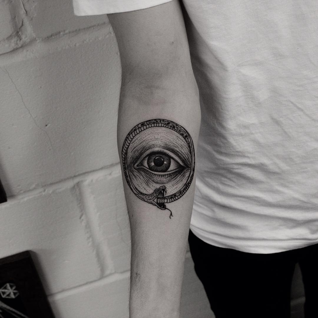 Ouroboros eye tattoo by Oliver Whiting