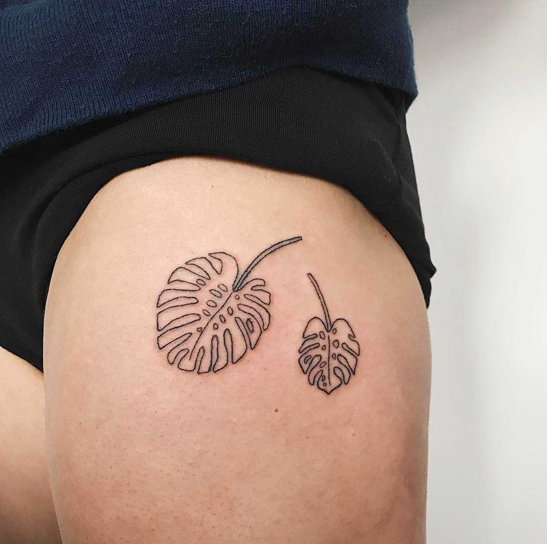 Pair of monstera leaves by Kelli Kikcio
