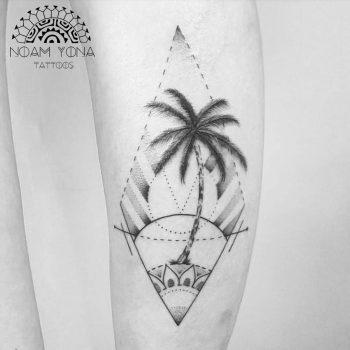Palm tree and sunset tattoo