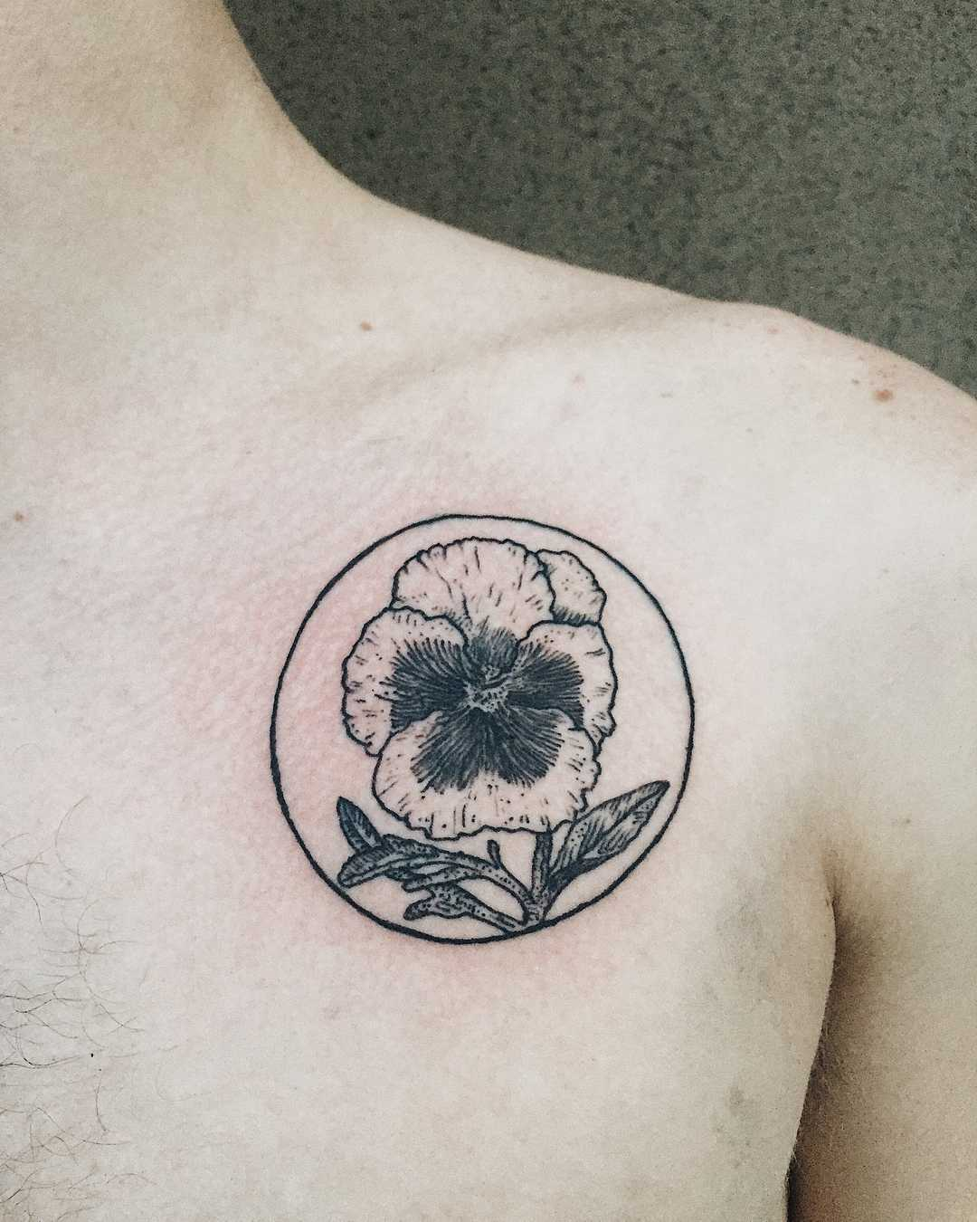 Pansy tattoo on the chest by Finley Jordan