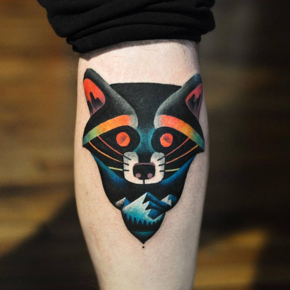 Raccoon and mountains tattoo