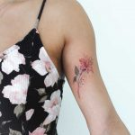 Red flower tattoo by Iris Art