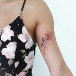 Red flower tattoo by Iris Art