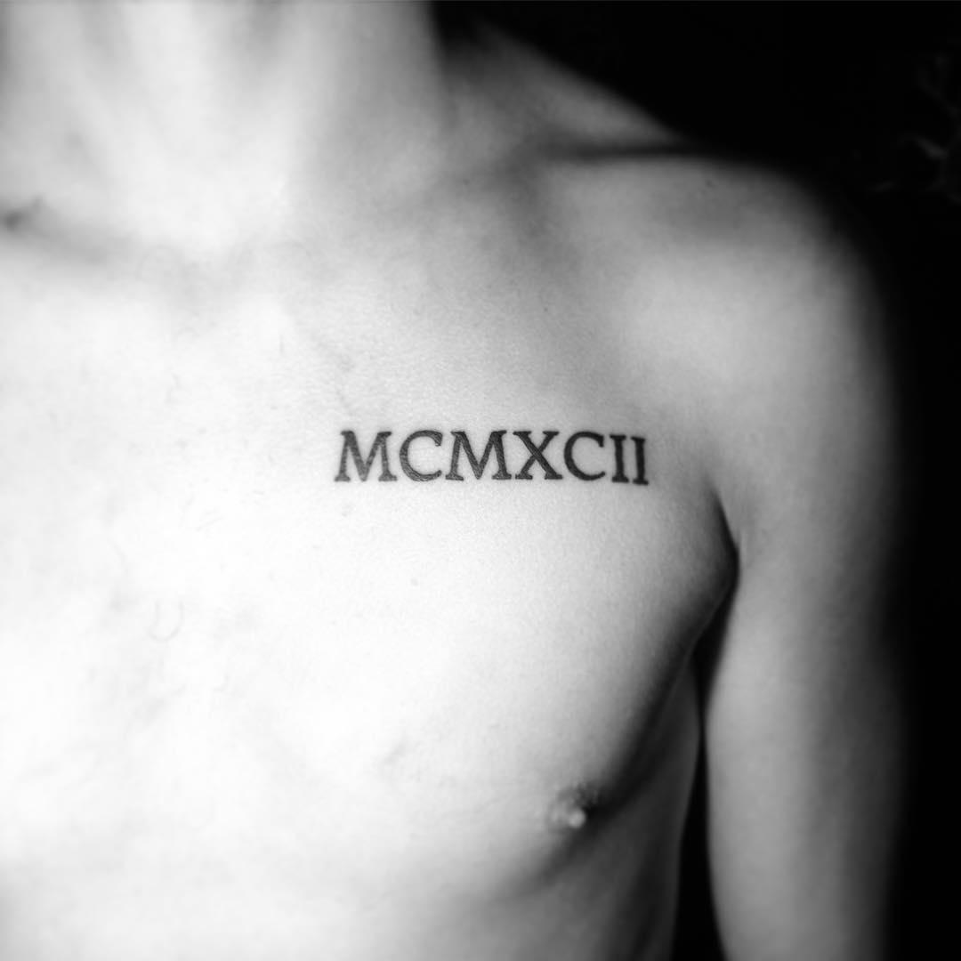 Roman numerals MCMXXII tattoo