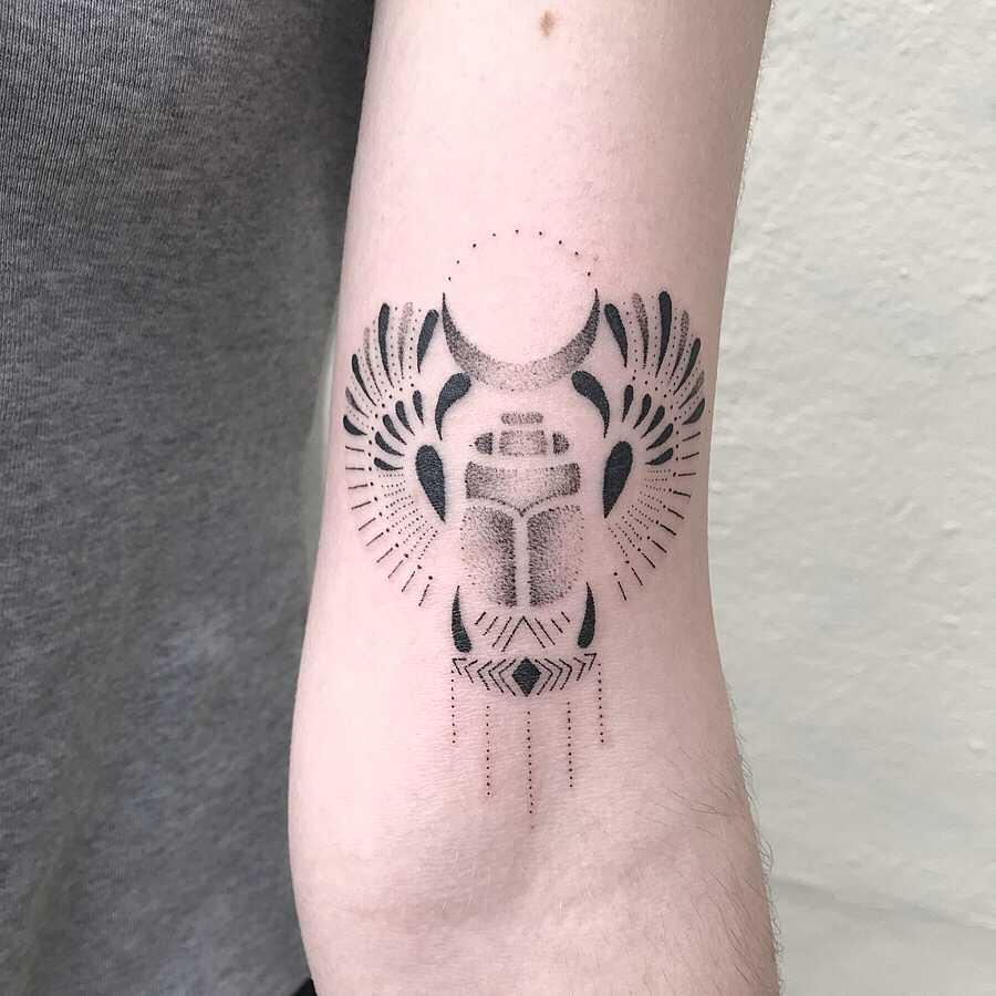 Scarab beetle tattoo by Femme Fatale