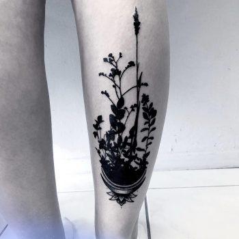 Shadow flowers tattoo