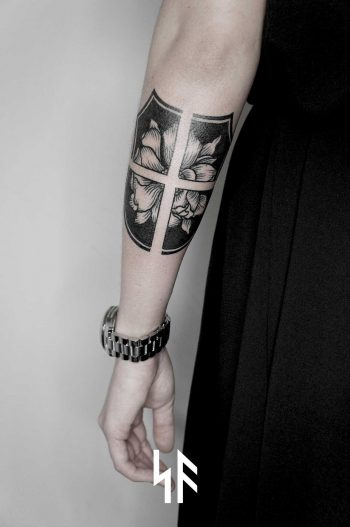 Shield tattoo by Andrei Svetov