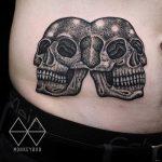 Siamese skulls tattoo