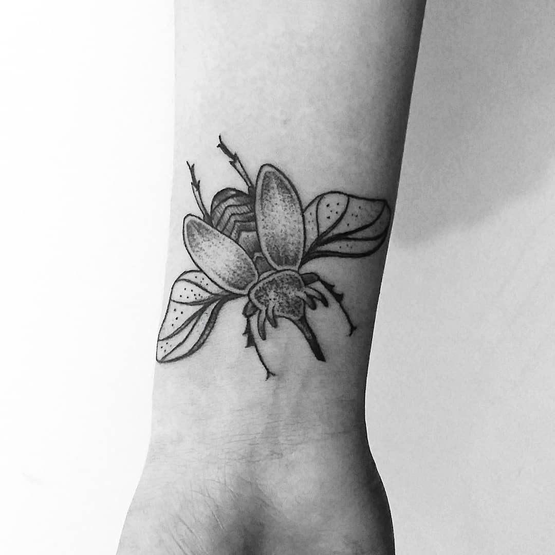 Sickle beetle tattoo