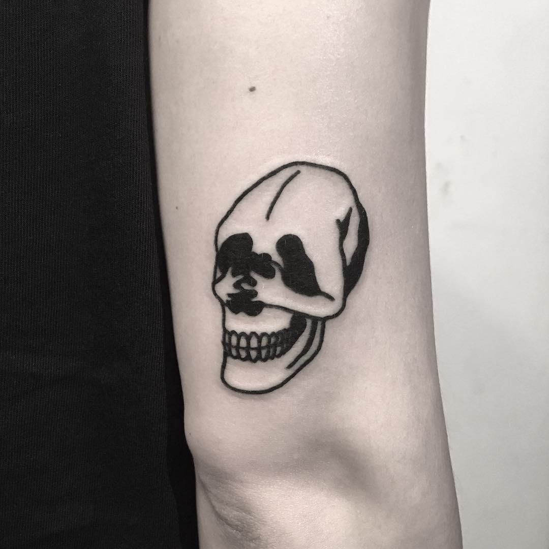 Skull and man tattoo