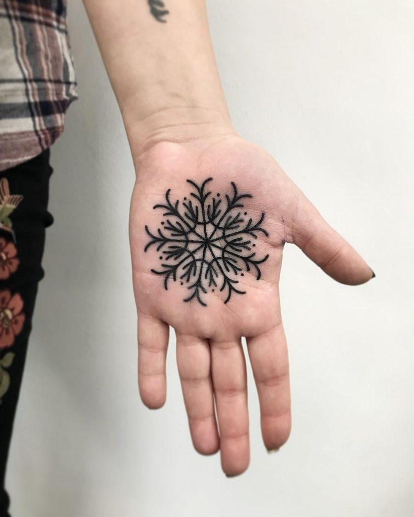 Snowflake tattoo on the palm by Łukasz Krupiński