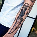 Stone dagger tattoo