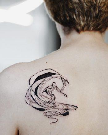 Surfer tattoo on a back