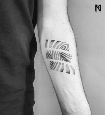 Swirl tattoo by Noam Yona