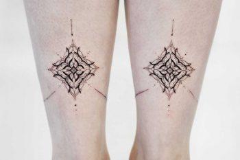 Symmetrical pattern tattoos