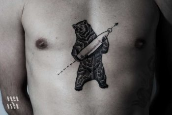 Tattoo of a bear with a bullet