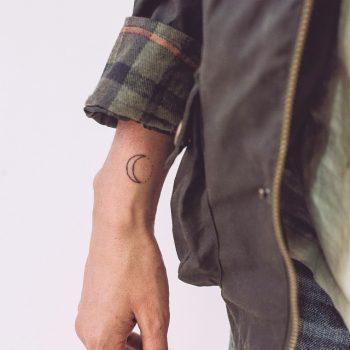 Tiny moon tattoo by Stanislava Pinchuk
