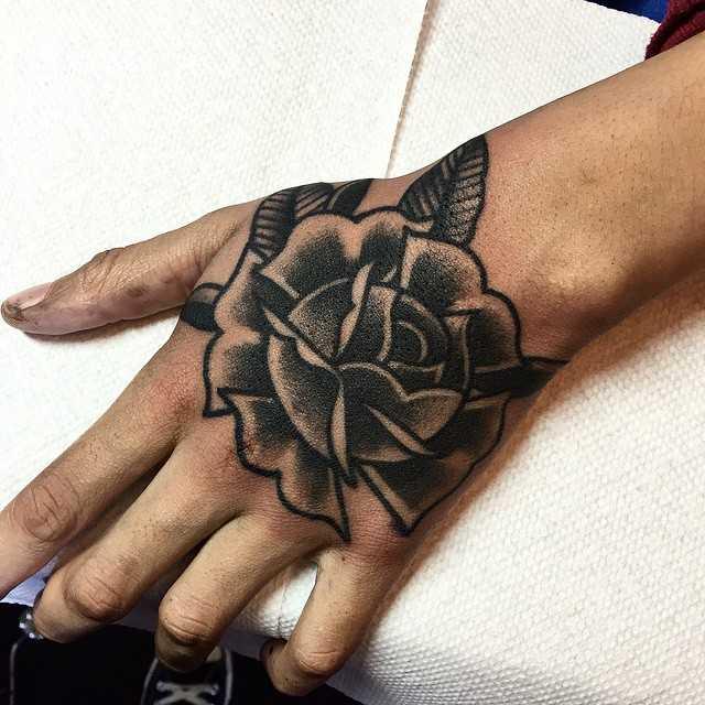 Traditional blackwork rose tattoo