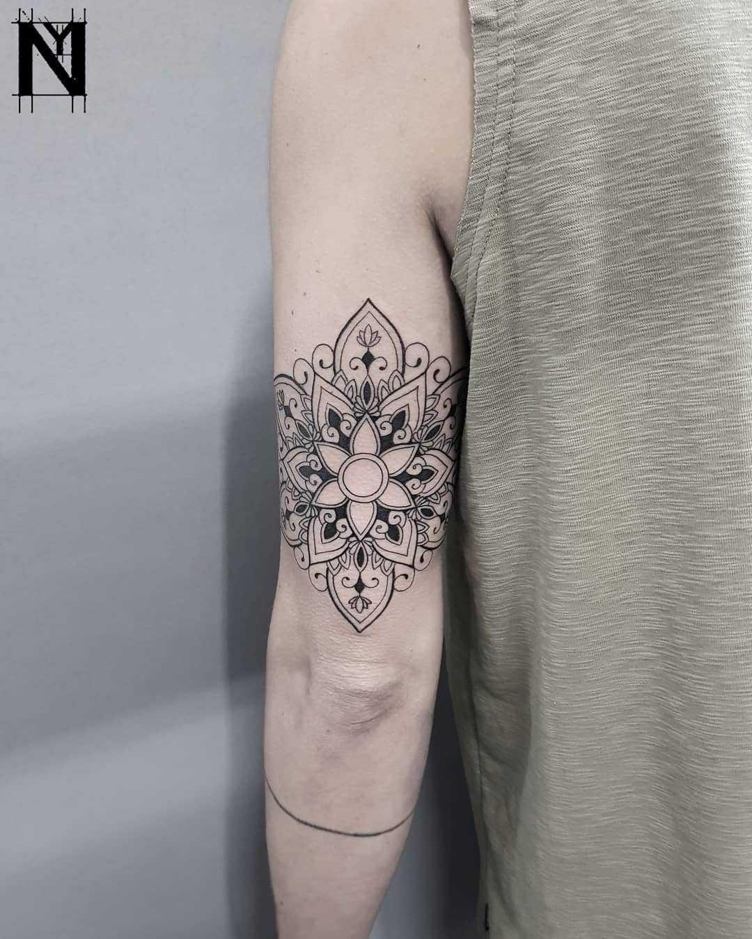 Triceps mandala tattoo by Noam Yona