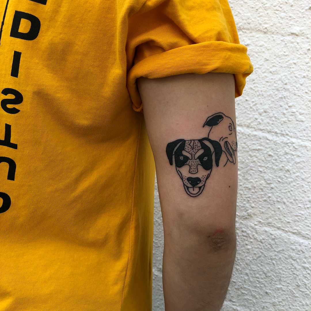Two puppies by tattooist yeahdope