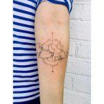 Upside down atlas tattoo by Zaya