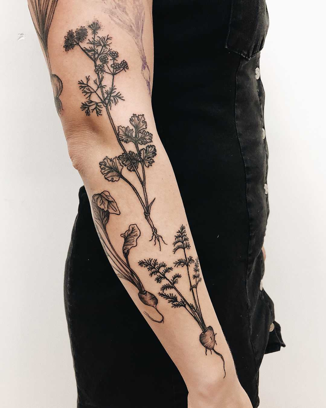 Various unearthed plant tattoos by Finley Jordan