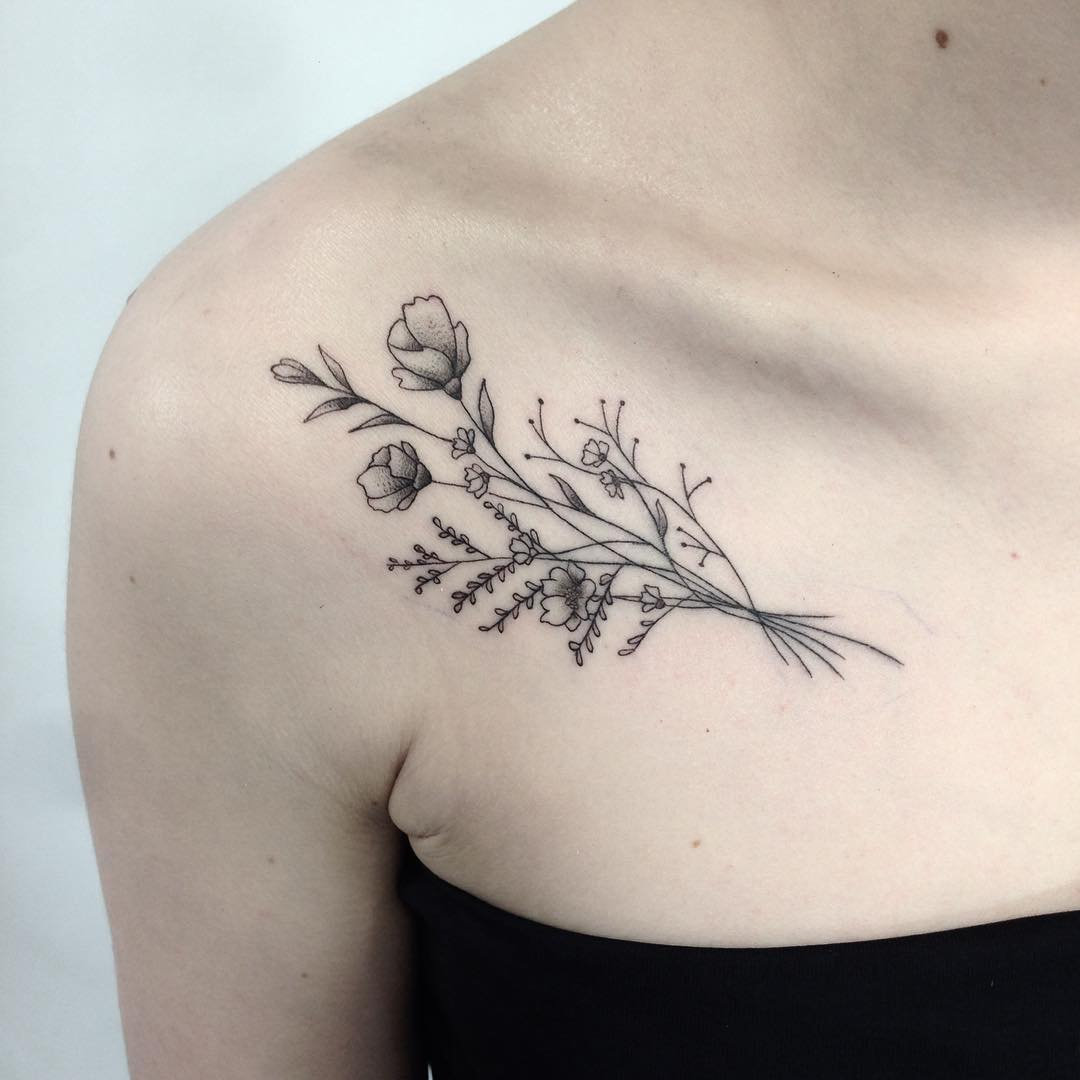 Wildflower bundle tattoo on the collarbone