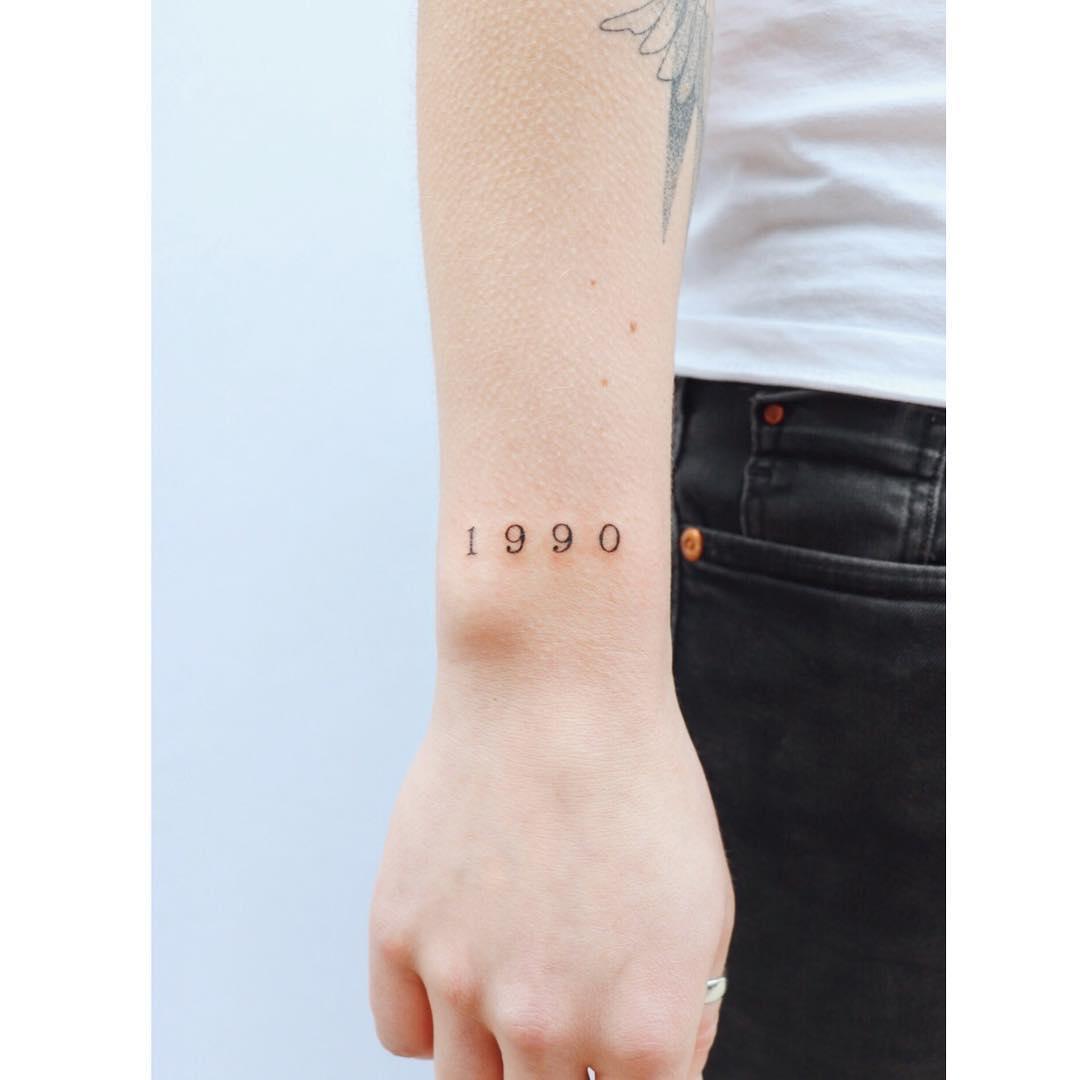 1990 tattoo by tattooist Zaya