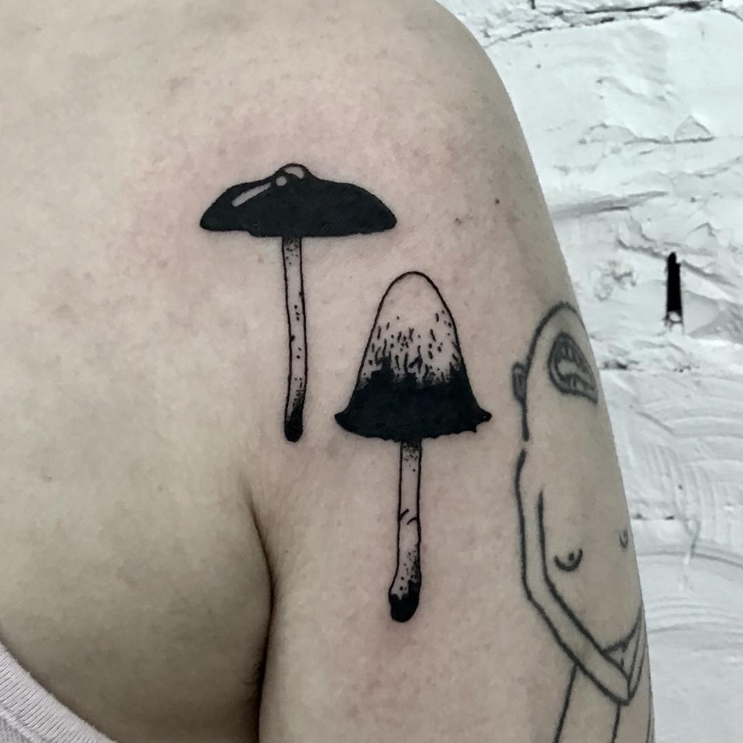A pair of mushrooms tattoo by Kevin Jenkins