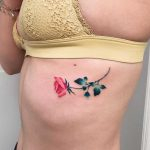 A small rose tattoo by Valeria Yarmola