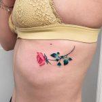 A small rose tattoo by Valeria Yarmola