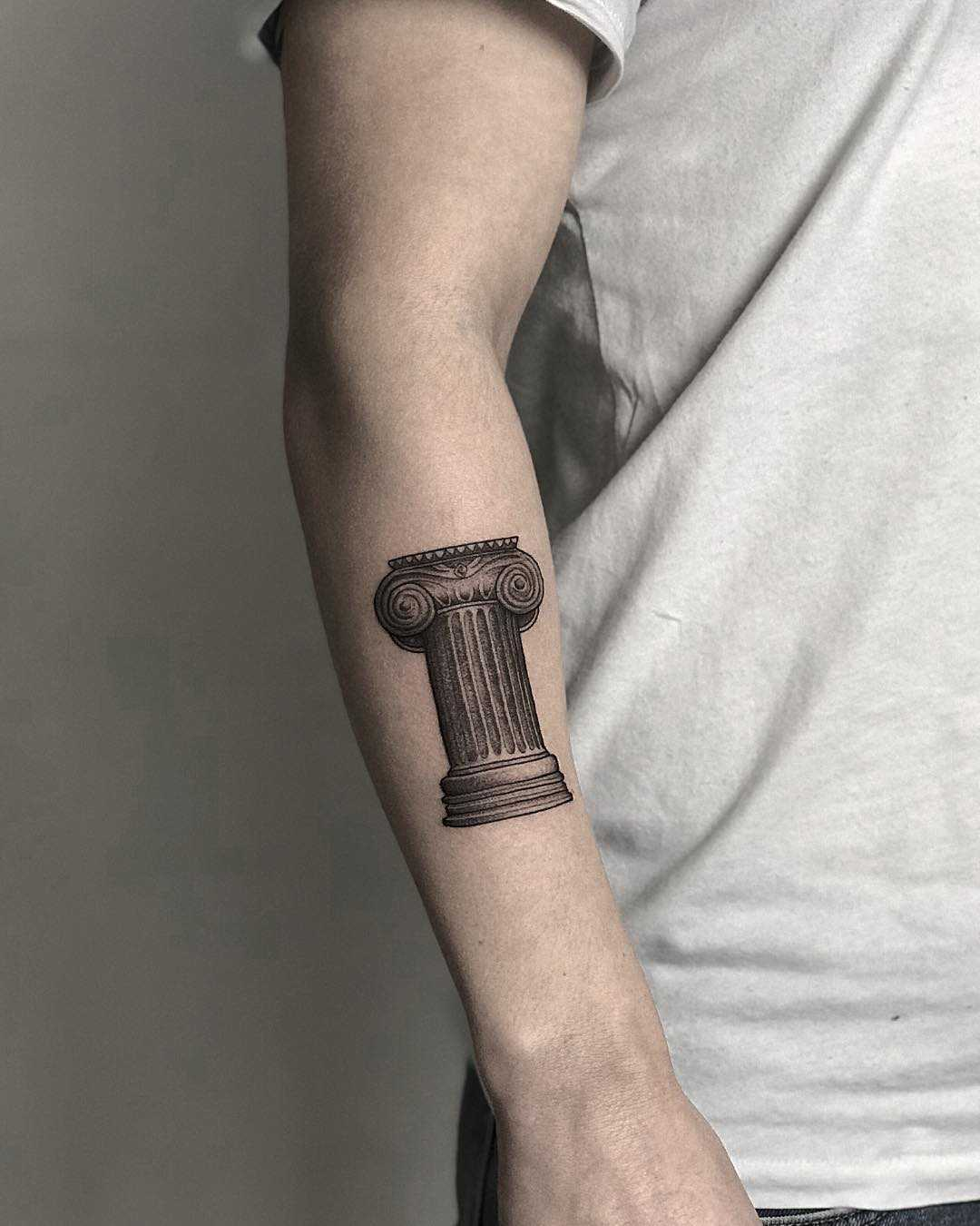Ancient pillar tattoo by tattooist Spence @zz tattoo