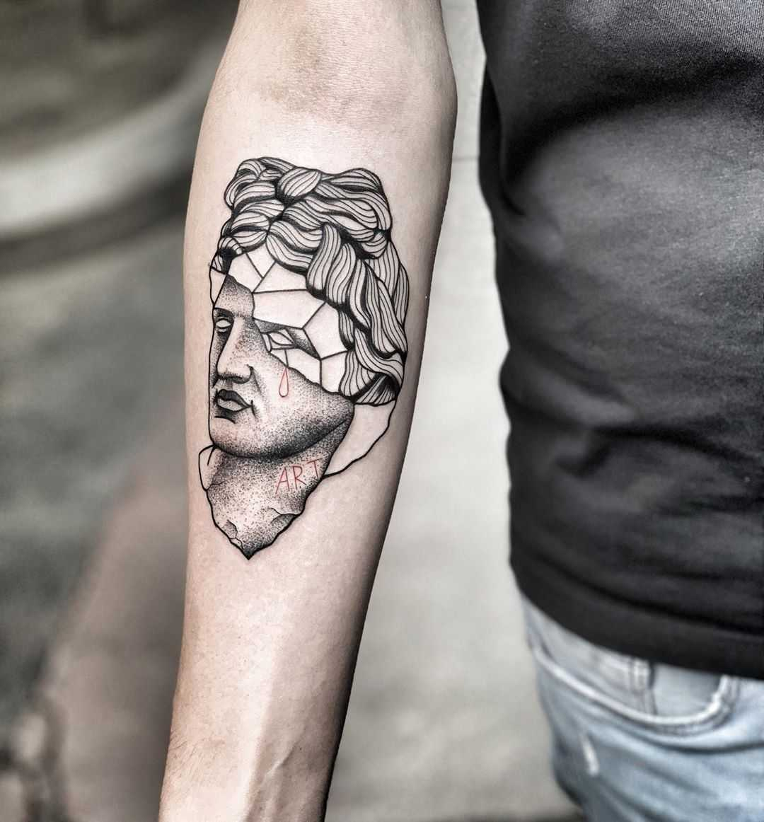 Apollo bust tattoo by Mike Nofuck