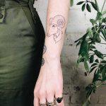 Aries ram with nautilus shells for horns tattoo by Kelli Kikcio