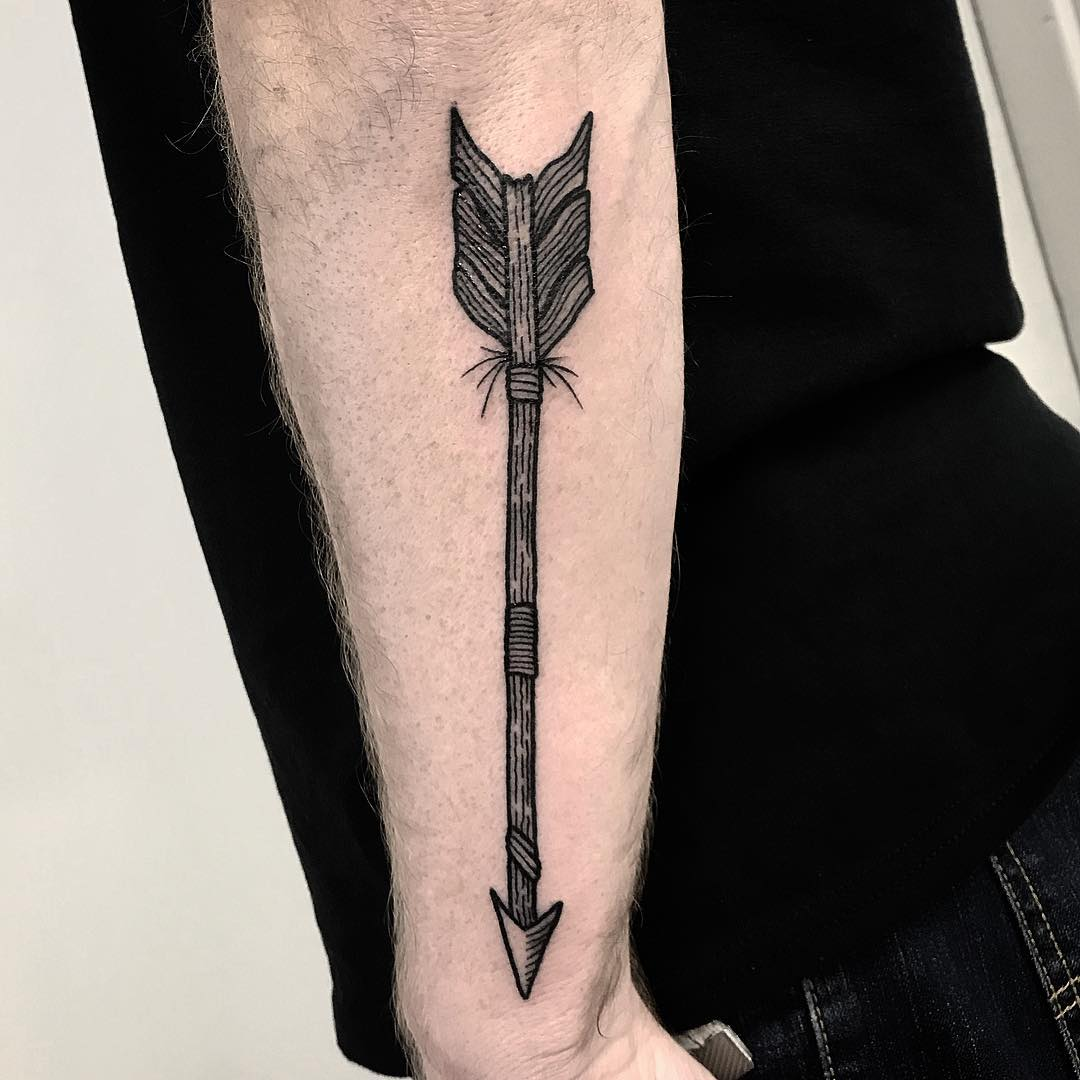 Arrow tattoo on the forearm by Deborah Pow