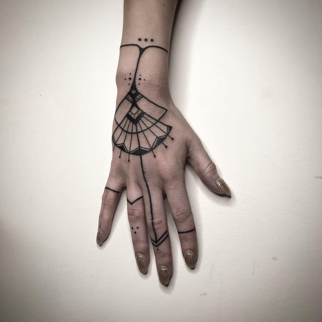 Beautiful hand tattoo by artist Meritattoon
